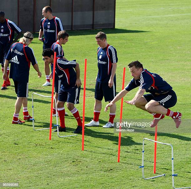 Ivica Olic of Bayern Muenchen jumps during the FC Bayern Muenchen training session at the Al Nasr training ground on January 6 2010 in Dubai United...