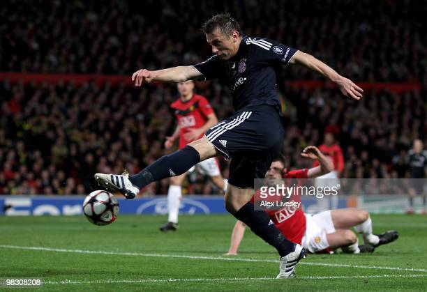 Ivica Olic of Bayern Muenchen scores his team's first goal during the UEFA Champions League Quarter Final second leg match between Manchester United...