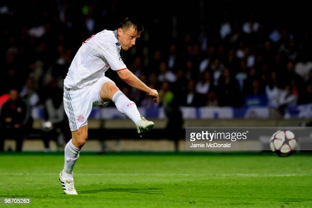 Ivica Olic of Bayern Muenchen scores his team's second goal during the UEFA Champions League semi final second leg match between Olympique Lyonnais...