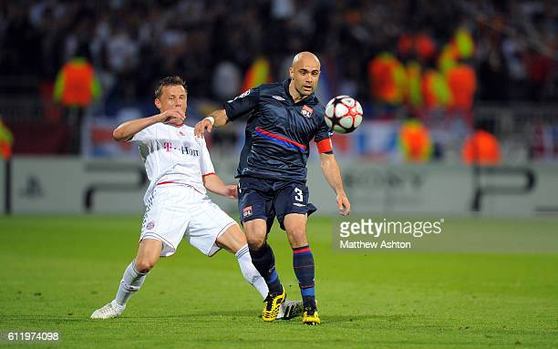 Ivica Olic of Bayern Munich and and Cris of Olympique Lyonnais