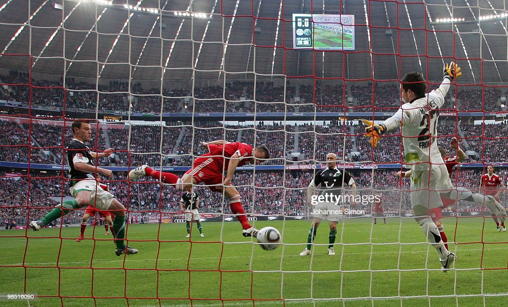 Ivica Olic (2L) of Bayern scores his team's first goal during the Bundesliga match between FC Bayern Muenchen and Hannover 96 at Allianz Arena on April 17, 2010, in Munich, Germany.