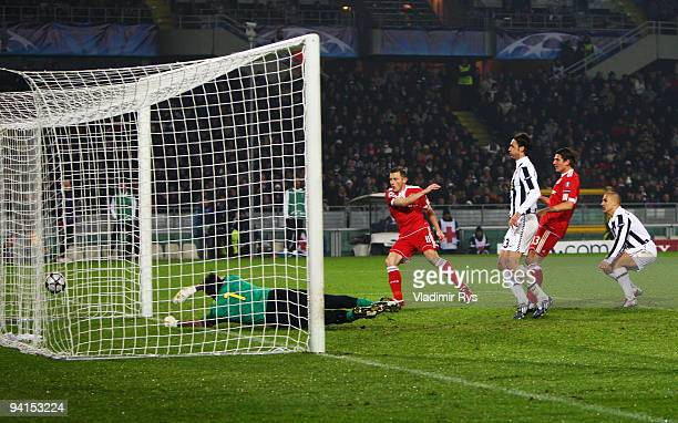 Ivica Olic of Bayern scores his team's second goal against Gianluigi Buffon of Juventus during the UEFA Champions League Group A match between...
