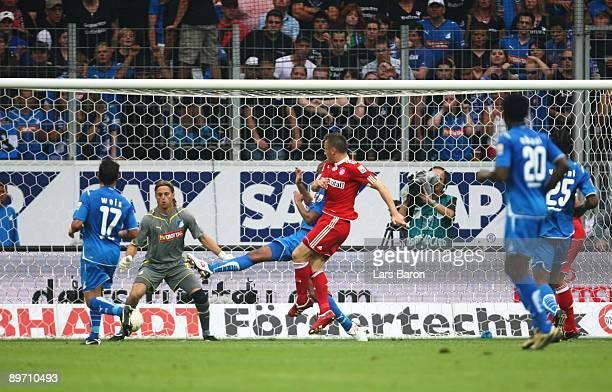 Ivica Olic of Bayern scores the opening goal against goalkeeper Timo Hildebrand during the Bundesliga match between 1899 Hoffenheim and FC Bayern...