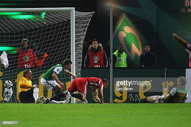 Ivica Olic of Bayern scores the second goal against goalkeeper Tim Wiese of Bremen during the DFB Cup final match between SV Werder Bremen and FC...