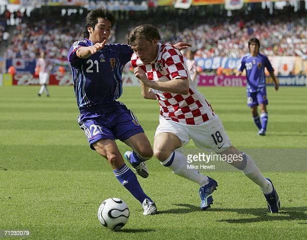 Ivica Olic of Croatia attempts to go past Akira Kaji of Japan during the FIFA World Cup Germany 2006 Group F match between Japan and Croatia at the...