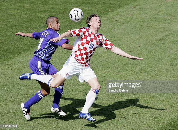 Ivica Olic of Croatia battles for the ball with Alessandro Santos of Japan during the FIFA World Cup Germany 2006 Group F match between Japan and...