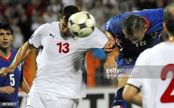 Ivica Olic of Croatia scores past Vitali Kutuzov of Belarus during a 2010 FIFA World Cup Qualifying football match in Minsk on August 12, 2009. AFP...