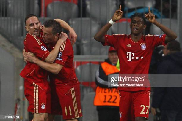 Ivica Olic of FC Bayern Muenchen celebrates scoring his second team goal with his team mate Franck Ribery and David Alaba during the UEFA Champions...