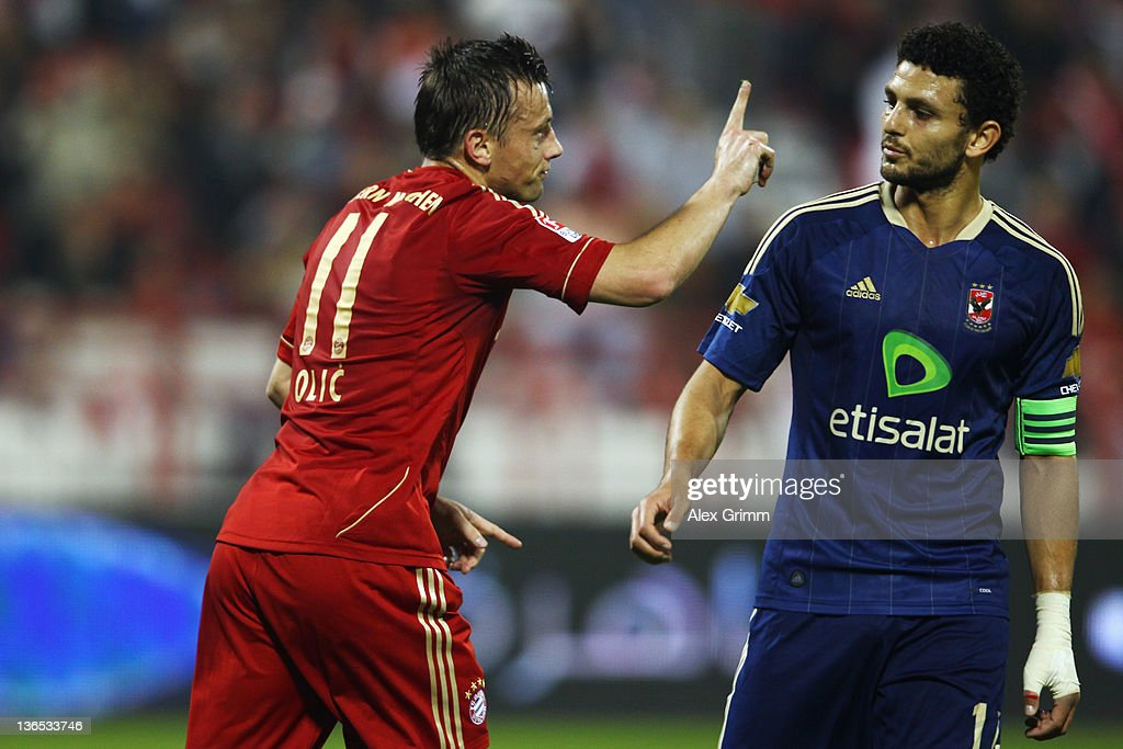 Ivica Olic (R) of Muenchen celebrates his team's first goal as Hossam Ghaly of Al-Ahly reacts during the international friendly match between Al-Ahly Cairo and Bayern Muenchen at Al-Rayyan Stadium on January 7, 2012 in Doha, Qatar.