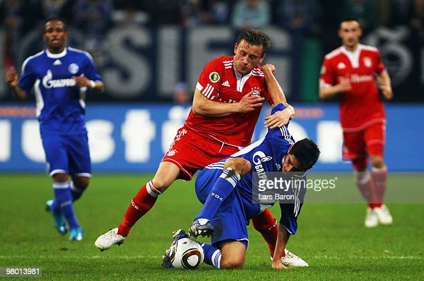 Ivica Olic of Muenchen challenges Carlos Zambrano of Schalke during the DFB Cup semi final match between FC Schalke 04 and FC Bayern Muenchen at...