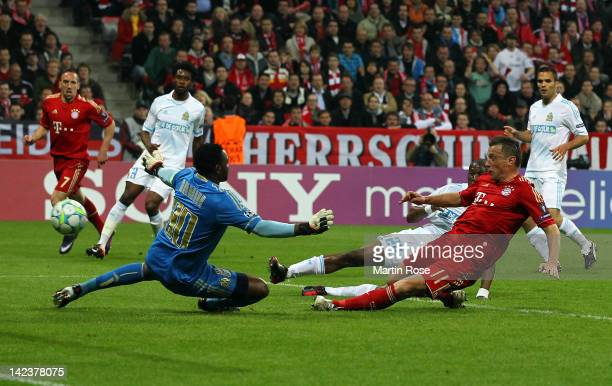 Ivica Olic of Muenchen scores his team's opening goal during the UEFA Champions League quarterfinal second leg match at Allianz Arena on April 3 2012...