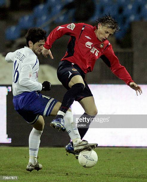 Ivica Olic of PFC CSKA Moscow competes for the ball with Leandro Fernandez of FC Dynamo Moscow during the Football Russian League Championship match...
