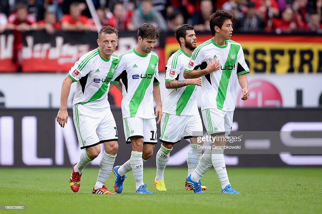Ivica Olic of VfL Wolfsburg celebrates with teammates after scoring his team's first goal during the Bundesliga match between Bayer 04 Leverkusen and VfL Wolfsburg at BayArena on September 14, 2013 in Leverkusen, Germany.