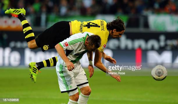 Ivica Olic of Wolfsburg and neven Subotic of Dortmund battle for the ball during the Bundesliga match between VfL Wolfsburg and Borussia Dortmund at...