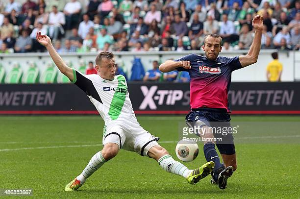 Ivica Olic of Wolfsburg and Pavel Krmas of Freiburg challenge for the ball during the Bundesliga match between VfL Wolfsburg and SC Freiburg at...