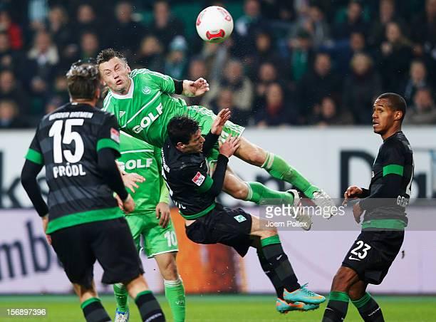 Ivica Olic of Wolfsburg and Zlatko Junuzovic of Bremen compete for the ball during the Bundesliga match between VfL Wolfsburg and SV Werder Bremen at...