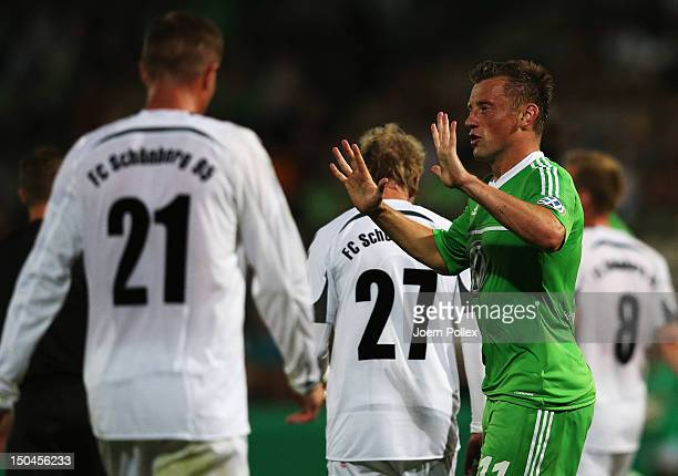 Ivica Olic of Wolfsburg celebrates after scoring his team's second goal during the DFB Cup first round match between SV FC Schoenberg 95 and VfL...
