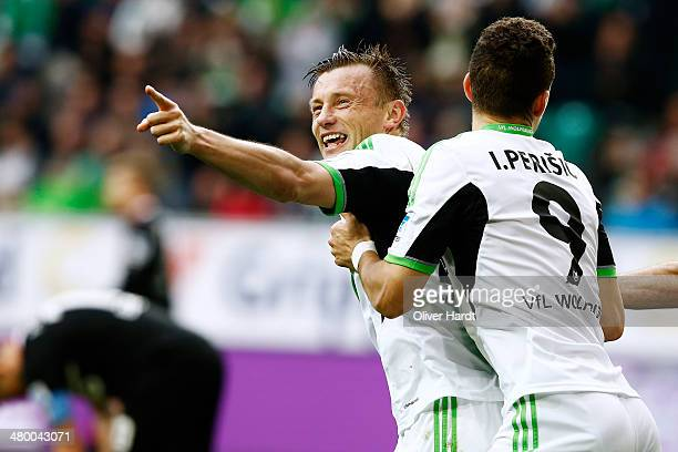 Ivica Olic of Wolfsburg celebrates after scoring their first goal during the Bundesliga match between and VfL Wolfsburg and FC Augsburg at Volkswagen...