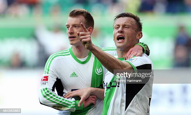 Ivica Olic of Wolfsburg celebrates his team's opening goal with Maximilian Arnold of Wolfsburg during the Bundesliga match between VfL Wolfsburg and...