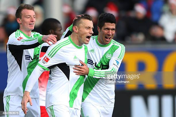 Ivica Olic of Wolfsburg celebrates his team's second goal with team mates Maximilian Arnold of Wolfsburg and Slobodan Medojevic of Wolfsburg during...