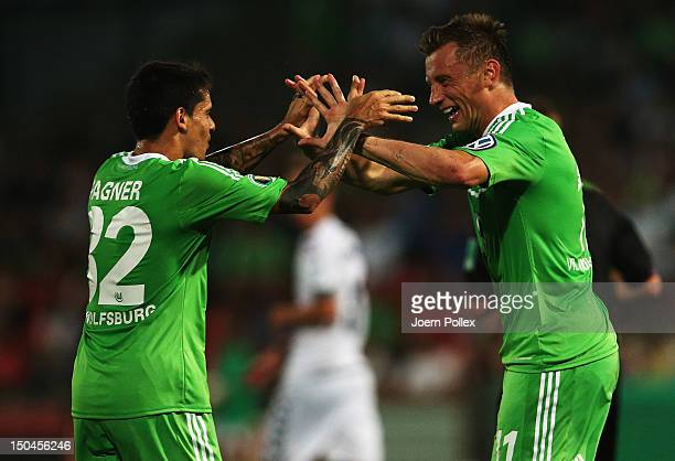 Ivica Olic of Wolfsburg celebrates with his team mate Fagner after scoring his team's second goal during the DFB Cup first round match between SV FC...