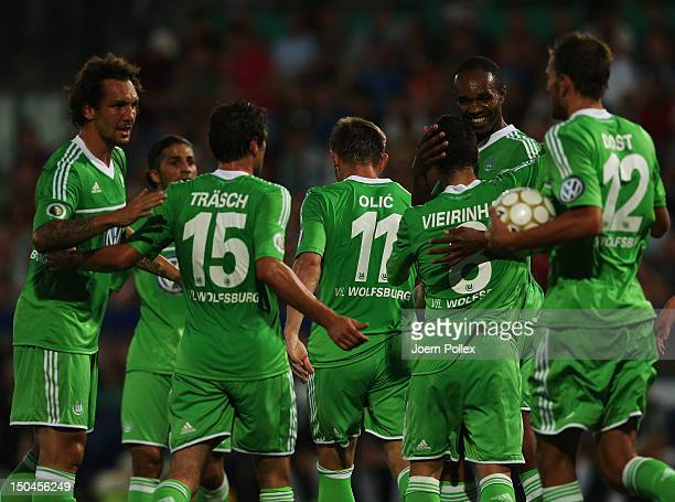 Ivica Olic of Wolfsburg celebrates with his team mates after scoring his team's first goal during the DFB Cup first round match between SV FC...