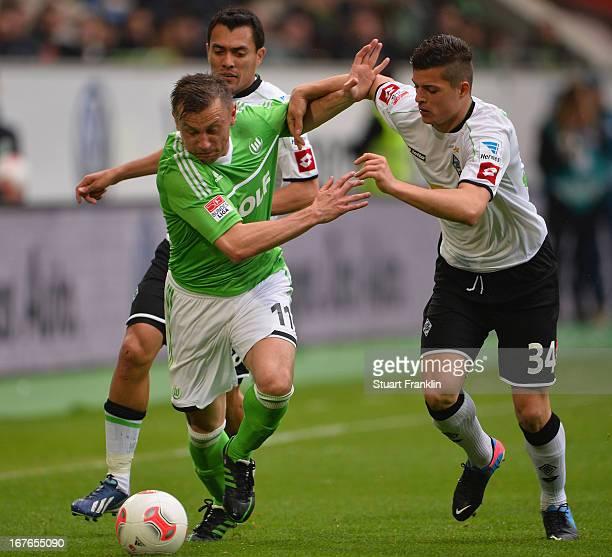 Ivica Olic of Wolfsburg is challenged by Granit Xhaka of Gladbach during the Bundesliga match between VfL Wolfsburg and VfL Borussia Moenchengladbach...