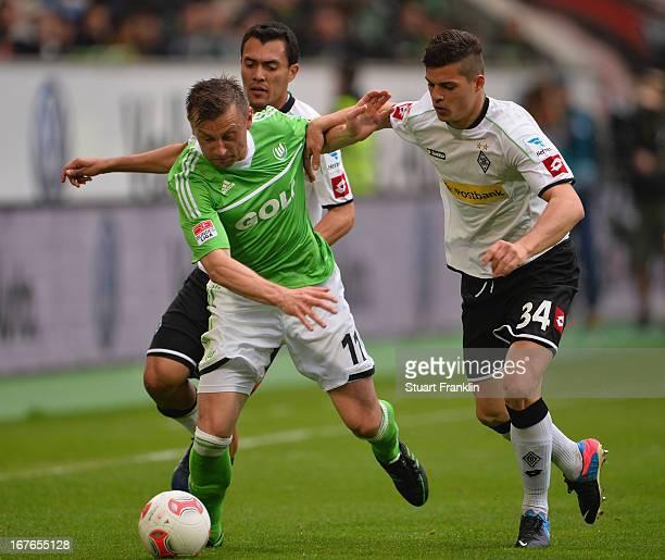 Ivica Olic of Wolfsburg is challenged by Juan Arango and Granit Xhaka of Gladbach during the Bundesliga match between VfL Wolfsburg and VfL Borussia...