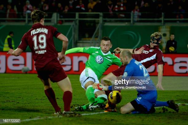 Ivica Olic of Wolfsburg misses a chance at goal against goalkeeper Robert Wulnikowski of Offenbach during the DFB Cup match between Kickers Offenbach...