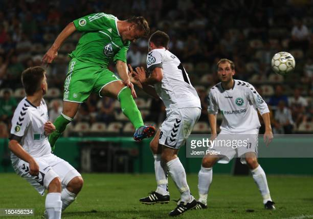Ivica Olic of Wolfsburg scores his team's second goal during the DFB Cup first round match between SV FC Schoenberg 95 and VfL Wolfsburg at Stadion...
