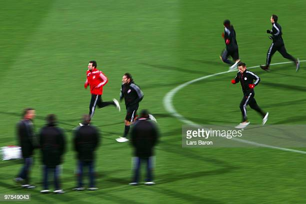 Ivica Olic warms up with team mates during a Bayern Muenchen training session at Artemio Franchi Stadium on March 8 2010 in Florence Italy Muenchen...