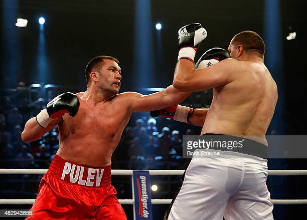 Ivica Perkovic of Croatia exchanges punches with Kubrat Pulev of Bulgaria during their heavyweight fight at Stadthalle Rostock on April 5 2014 in...