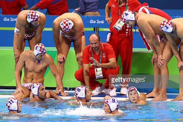 Ivica Tucak coach of Croatia talks to his players in the Men's Water Polo Gold Medal match between Croatia and Serbia on Day 15 of the Rio 2016...