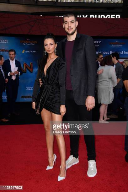 Ivica Zubac and guest attend the Premiere Of Sony Pictures' SpiderMan Far From Home at TCL Chinese Theatre on June 26 2019 in Hollywood California