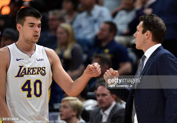 Ivica Zubac and head coach Luke Walton of the Los Angeles Lakers fist bump in the first half of a game against the Utah Jazz at Vivint Smart Home...