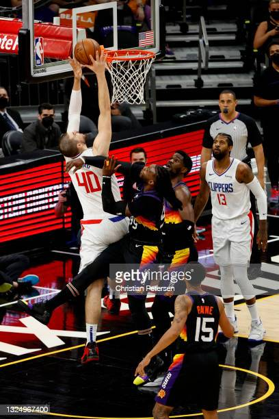 Ivica Zubac of the LA Clippers drives to the basket in the first quarter during game two of the Western Conference Finals against the Phoenix Suns at...
