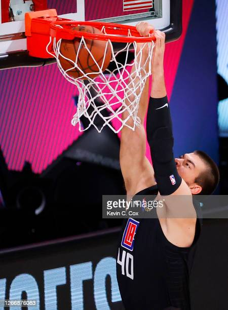 Ivica Zubac of the LA Clippers dunks against the Dallas Mavericks in Game One of the Western Conference First Round during the 2020 NBA Playoffs at...