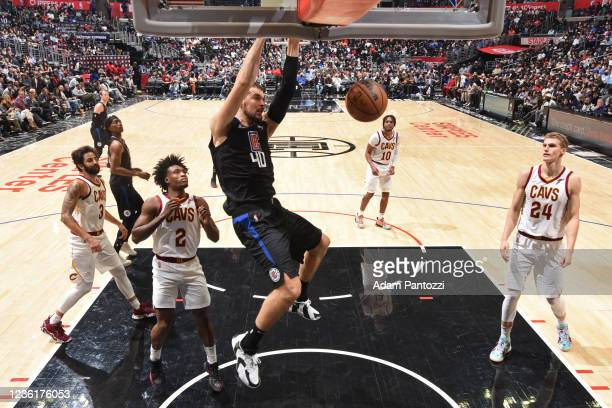 Ivica Zubac of the LA Clippers dunks the ball against the Cleveland Cavaliers on October 27, 2021 at STAPLES Center in Los Angeles, California. NOTE...