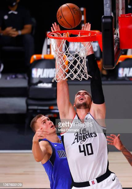 Ivica Zubac of the LA Clippers goes up for a shot against Kristaps Porzingis of the Dallas Mavericks during the second quarter in Game Three of the...