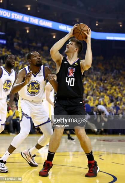 Ivica Zubac of the LA Clippers goes up for a shot on Kevin Durant of the Golden State Warriors during Game One of the first round of the 2019 NBA...