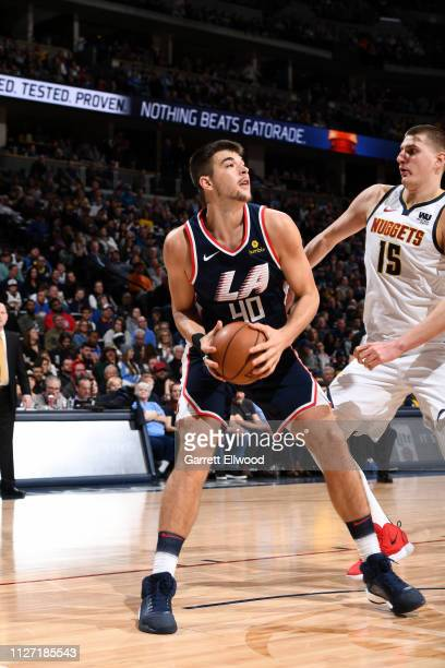 Ivica Zubac of the LA Clippers handles the ball against the Denver Nuggets on February 24 2019 at the Pepsi Center in Denver Colorado NOTE TO USER...