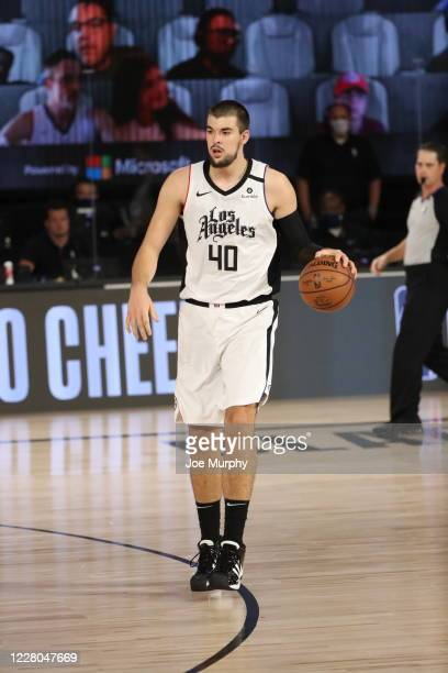 Ivica Zubac of the LA Clippers handles the ball during the game against the Oklahoma City Thunder on August 14, 2020 at The Field House at ESPN Wide...