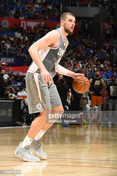 Ivica Zubac of the LA Clippers handles the ball during the game against the Phoenix Suns during Game 4 of the Western Conference Finals of the 2021...