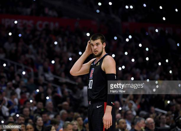 Ivica Zubac of the LA Clippers waits for the start of play against the Denver Nuggets during the fourth quarter in a 132-103 Clippers win at Staples...