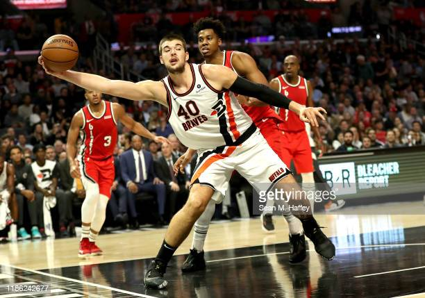 Ivica Zubac of the Los Angeles Clippers rebounds against Hassan Whiteside of the Portland Trail Blazers during the second half of a game at Staples...