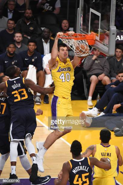 Ivica Zubac of the Los Angeles Lakers dunks the ball during the preseason game against the Utah Jazz on October 10 2017 at STAPLES Center in Los...