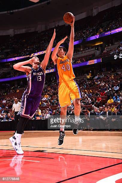 Ivica Zubac of the Los Angeles Lakers goes to the basket against George Papagiannis of the Sacramento Kings during a preseason game on October 4 2016...