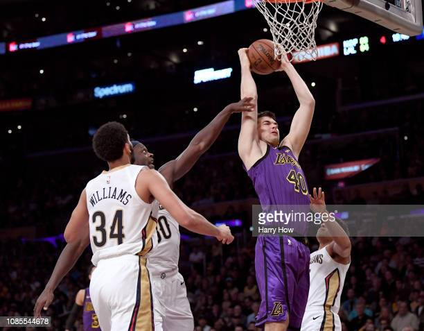 Ivica Zubac of the Los Angeles Lakers grabs a rebound in front of Julius Randle Kenrich Williams and Frank Jackson of the New Orleans Pelicans during...