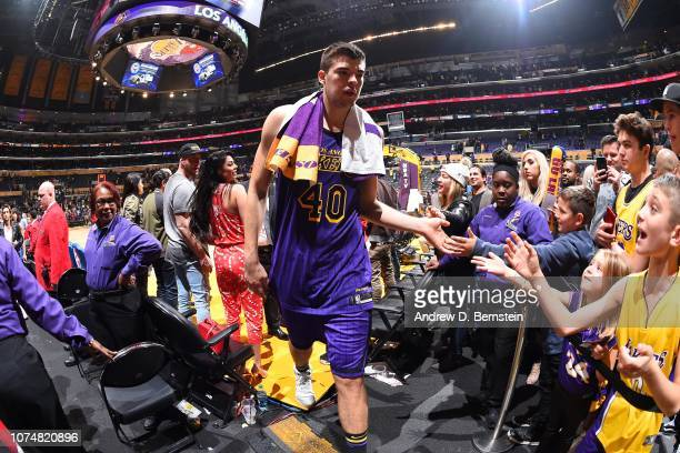 Ivica Zubac of the Los Angeles Lakers highfives fans after a game against the New Orleans Pelicans on December 21 2018 at STAPLES Center in Los...
