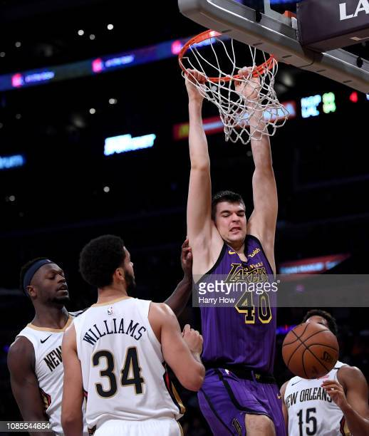 Ivica Zubac of the Los Angeles Lakers reacts to his dunk in front of Julius Randle Kenrich Williams and Frank Jackson of the New Orleans Pelicans...